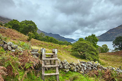 Looking back at Loch Lomond after crossing a stone wall along the Way.  Scotland.