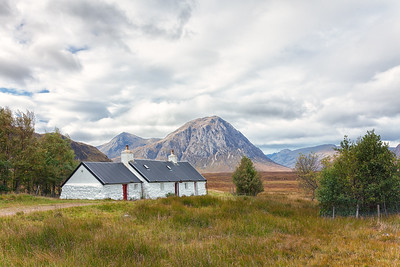 After descending into Glen Coe, Blackrock Cottage sits on the road with Stob Dearg and the Buachaille Etive Mor in the background.  Scotland.