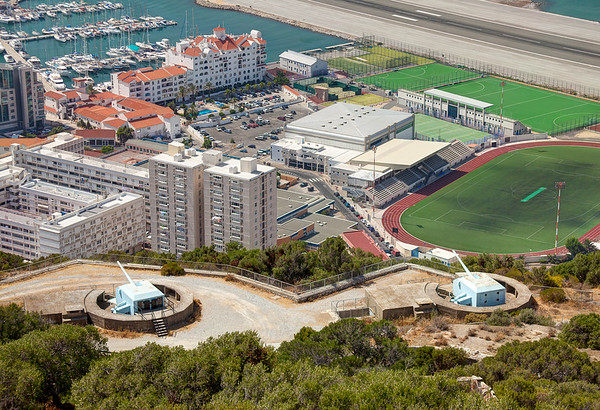 Old gun turrets sit watch over condos and soccer fields in Gibraltar.