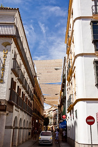 Looking down one of the narrow alleys in Seville, Spain.