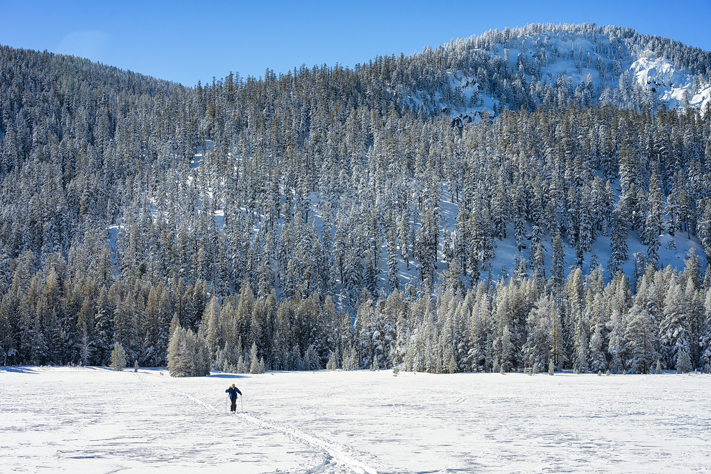 A skier crossing Grass Lake.