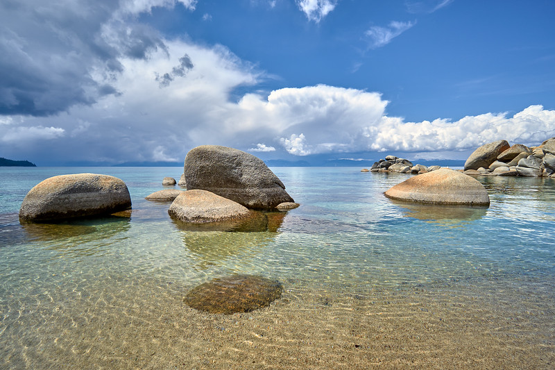 The clear waters of Chimney Beach, looking towards storms at south Lake Tahoe.