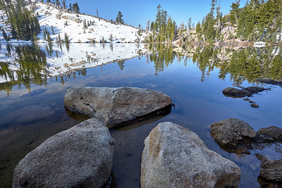 The shallow and clear waters of the Five Lakes.