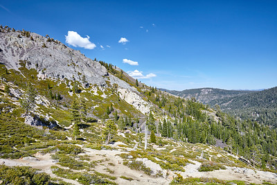 Looking towards the Truckee River valley from the line of ski lift towers on the Five Lakes trail.