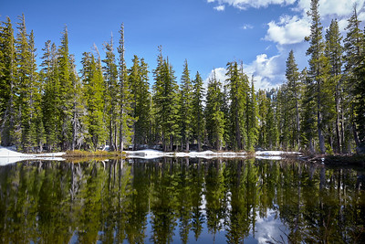 Afternoon reflections in the first lake visible on the Five Lakes trail.