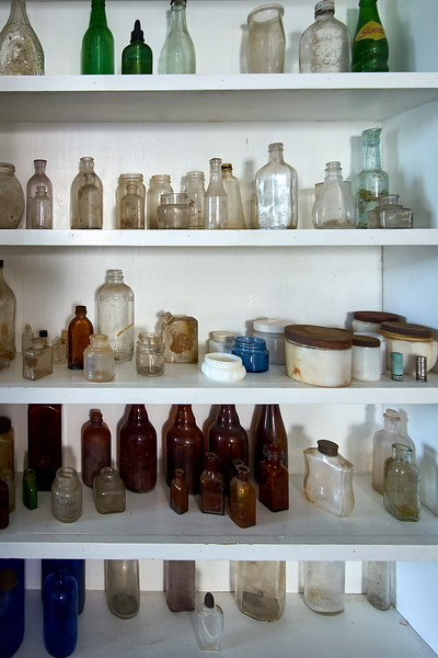 Collection of old bottles in the Webber Lake Hotel