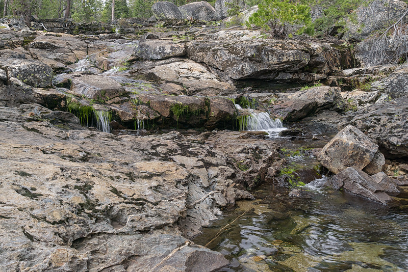 Water cascading down the granite along the Loch Leven Lakes trail.
