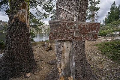 The old wooden sign announcing your arrival to Middle Loch Leven Lake.