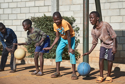 Boys participating in basketball drills during X-SUBA's Connection Day.  Every Saturday, youth in the community meet at a local church to play sports and engage in life skills lessons led by X-SUBA coaches.