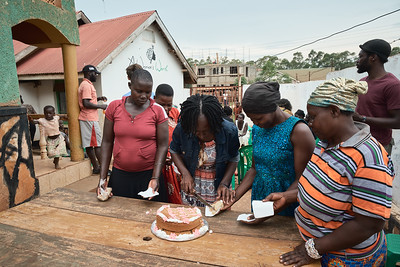 A Woman's Worth volunteers serving cake to local women during X-SUBA's celebration of International Women's Day.
