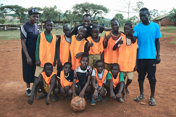 Coaches and teachers with the winning soccer team after a school sports tournament.  The uniforms and ball were provided by X-SUBA since many of the schools don't have a budget for a sports program.