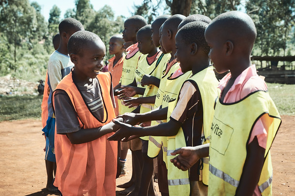 A great display of sportsmanship before a soccer game.  This was during a school sports tournament day at a local primary school.  X-SUBA provided the bibs and soccer balls; without them the kids would be playing with unserviceable equipment and no uniforms.