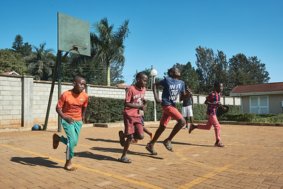 Boys running basketball drills during X-SUBA's Connection Day.  Every Saturday, youth in the community meet at a local church to play sports and engage in life skills lessons led by X-SUBA coaches.