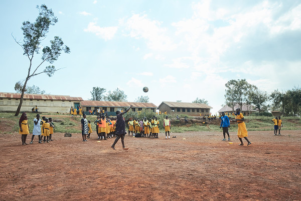 X-SUBA volunteer coach Jay Jay participating in ball handling & coordination drills at a local school.  The coaches go to a different school each day of the week to provide organized sports.  After some drills and warmups the students participate in soccer and netball games.