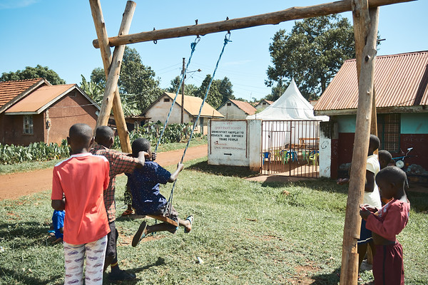 Children playing on a swing during a break at X-SUBA's Learning Center.  The swing was a gift and constructed by one of the European volunteers who visit X-SUBA.