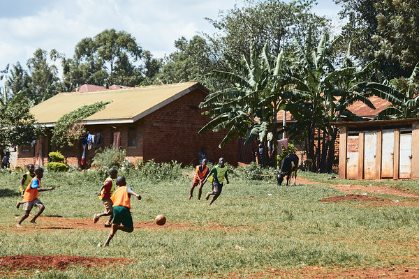 Students playing soccer during a school sports tournament.  The bibs and soccer ball were provided by X-SUBA since the school does not have the proper equipment.