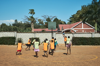 Girls playing netball during X-SUBA's Connection Day.  Children throughout the community gather on local church grounds every Saturday to socialize, play organized sports, and talk about life with X-SUBA's coaches.