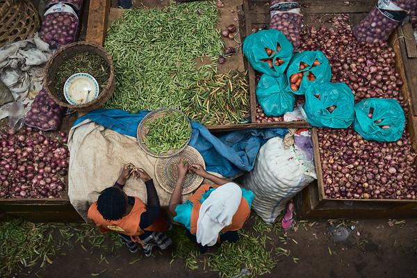 Women shelling beans in Jinja's Central Market.
