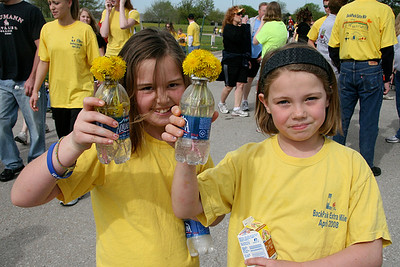 Participants in the BackPack Extra Mile Walk came away with a feeling of satisfaction – and dandelion bouquets