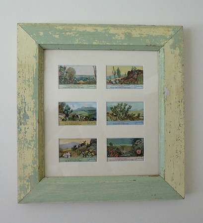 Advertising cards from the 1930s...made the frame from an old window sash.