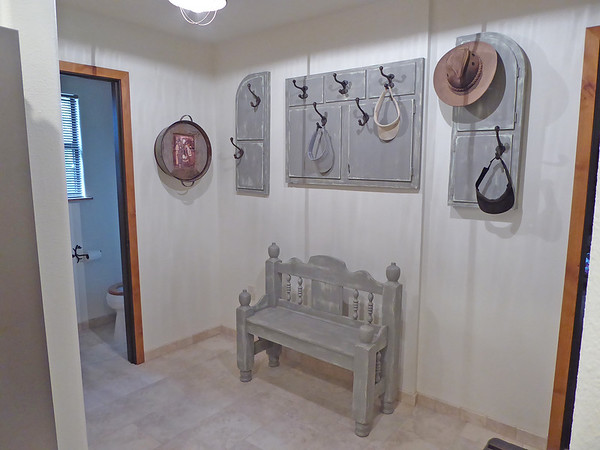 Entryway hat and coat rack were made from the front of an old hoosier cabinet - the bench was made from an old headboard and footboard.