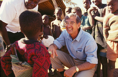 1999 - Millard Fuller talks with a child in Botswana.
