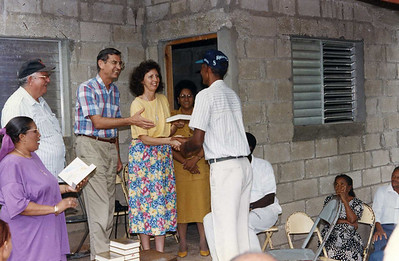 1994 Linda and Millard present Bible to new home owner in Barahona.