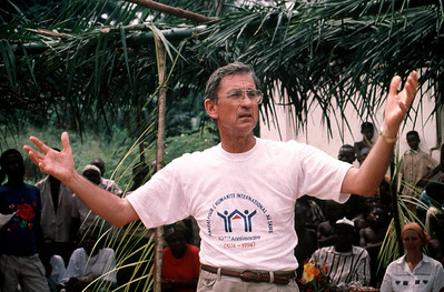 Millard Fuller, founder and president of Habitat for Humanity, speaks to a crowd in Bokoro, Zaire (now the Democratic Republic of Congo). (1995)