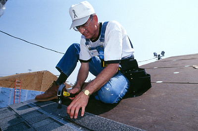 Millard Fuller roofing. (Jimmy Carter Work Project 1998)