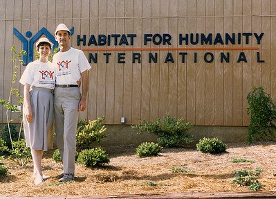 1988 - Millard and Linda Fuller, co-founders of Habitat for Humanity, pose in front of the Habitat for Humanity International headquarters building wearing Walk to Kansas City shirts.