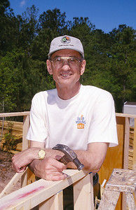 Millard Fuller at the Easter Morning Build site. (1998)