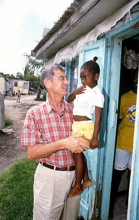 1997 - Millard Fuller visits a family living in substandard housing in Antigua.