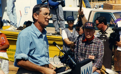 1987 Jimmy Carter with Millard doing an interview at a Habitat work site.