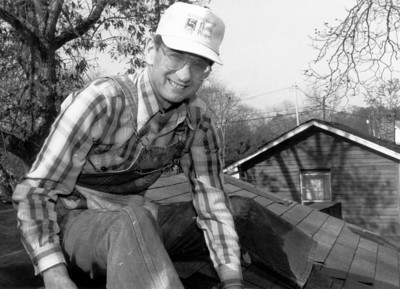Millard Fuller on a roof. (1991)