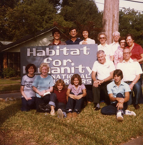 1980 - Fuller family members along with visisting group of volunteers. (Georgia Fuller is in red shirt, Faith Fuller in lavender. Chris Fuller is standing to the right of Linda & Millard behind the sign) lcf