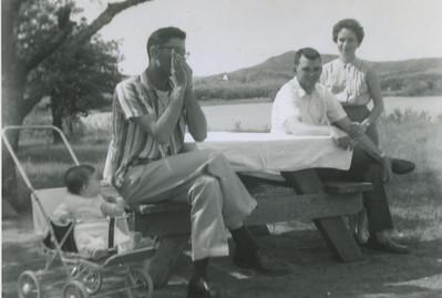 Millard playing harmonica.