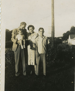 Millard, age 14, with stepmother Eunice, father Render Fuller and Nick, the first of 2 step brothers.