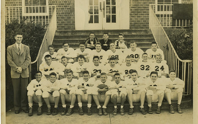 1949 - Millard (center) with middle school football team. He also enjoyed playing basketball and baseball.