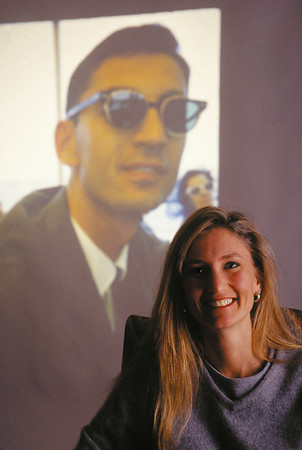2000 Faith Fuller, daughter of Millard and Linda Fuller and Senior Producer with Habitat for Humanity International, pictured with a 1966 photo of her father projected onscreen in the background.