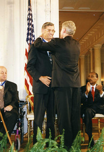 1996 - President William Clinton presents Millard Fuller with Medal of Freedom Award - highest civilian honor.
