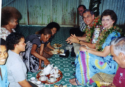 2001 Linda and Millard served tea by homeowners in Figi.