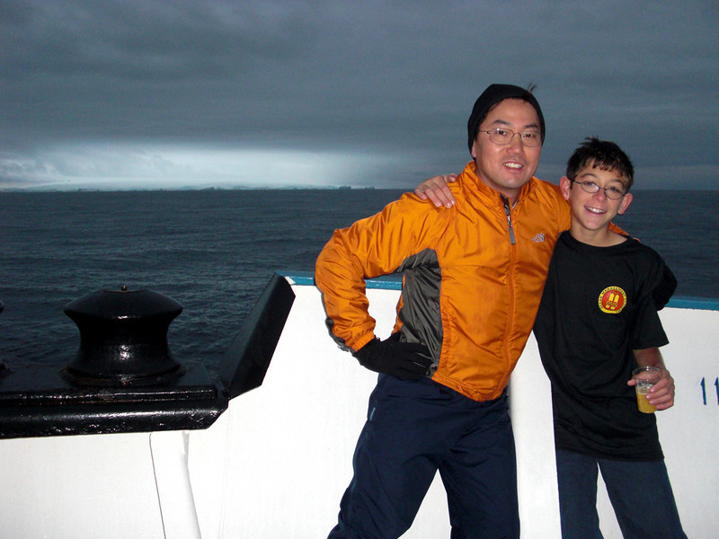 08f-Crossing the Antarctic Circle, latitude 66.56 degrees south, with Evan Bozanic, youngest (age 11) to scuba dive  in the Antarctic.  Just as impressive, Evan's grandmother, Lois, also shared a dive with us in the frigid waters!