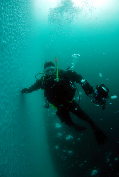 Diver, Pat Dykstra.  The bottom of the iceberg was smashing against the ocean bottom, making tremendous exploding sounds, sending a shower of ice upwards.  We had to be cautious of dinner plate sized chunks of ice rising up and potentially knocking us in the face.