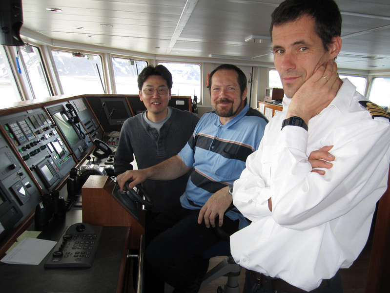 Kevin, Captain Evgeny Levakov (Russian) and First Officer Francois Kwekkeboom (Dutch) on the Plancius bridge