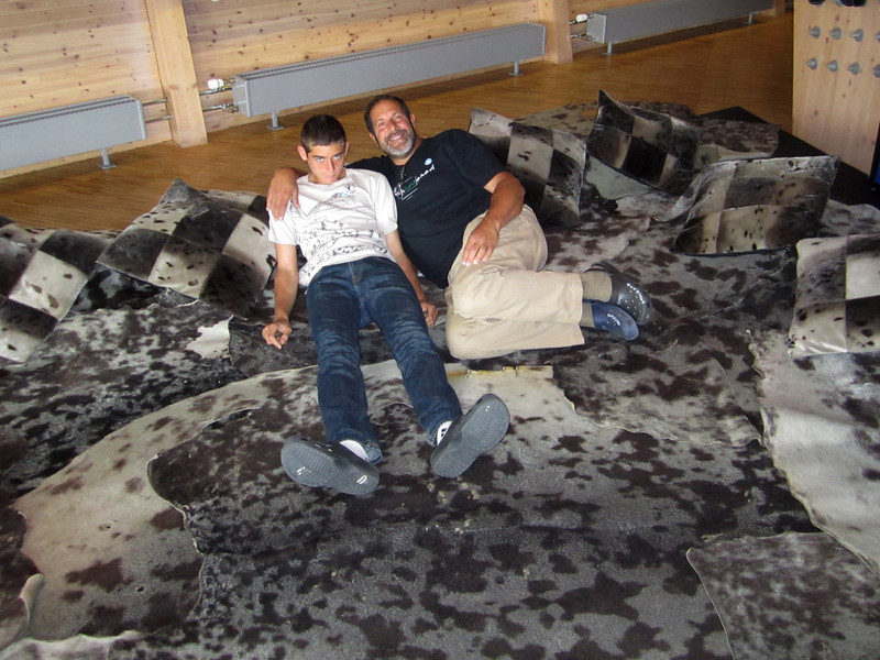 Evan and Jeff lounging on seal skins<br /> Svalbard Museum