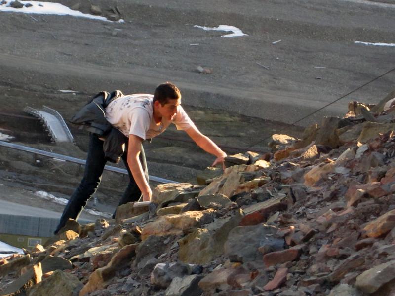 Evan climbing steep, rocky slope