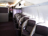 Individual business class seating aboard Virgin Atlantic.  Seats fold down to full horizontal beds.