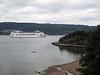 Massive cruise ship sailing toward Oslo, in Oslo Fjord, where it is very narrow here.