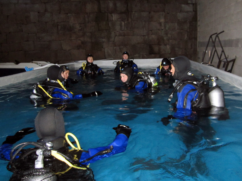 Fledgling divers taking lessons in an elevated swimming pool at ProDykk Dive Shop
