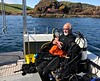 Jim warming up for the next dive.<br /> Near Eyemouth, Scotland